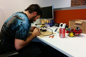 Jason repairing fire damaged robots