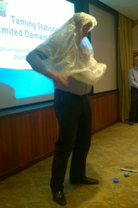 MD of Optima Systems models a rain poncho