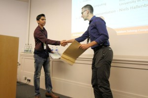 Joshua David receives his certificate from Niels Hallenberg