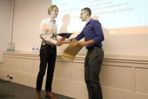 Zack Batik receives his certificate from Niels Hallenberg